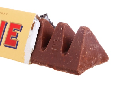 toblerone: An opened package of Toblerone milk chocolate isolated on white