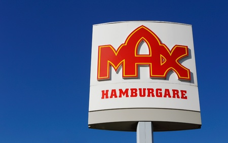 Sign at Max fast food restaurants in Sweden isolated on blue sky.