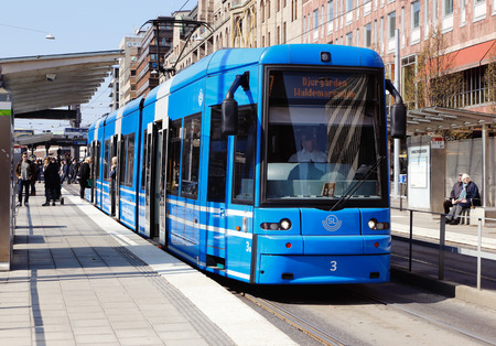 Stockholm, Sweden - April 19, 2014  Blue tram on line 7 with destination Djurgarden has stopped at the stop Kungstradgarden  Editorial