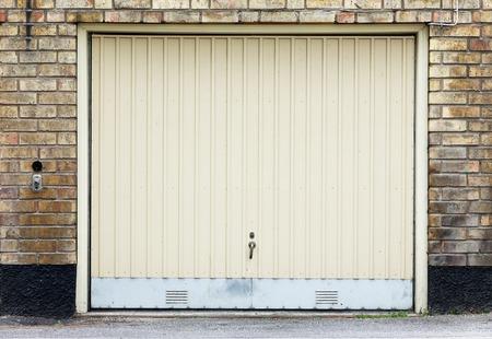 Garage door on brick wall