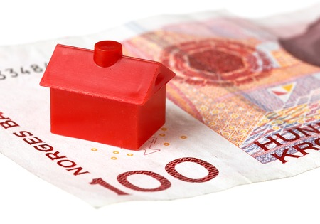 litle: Red litle house on Norwegian one hundred kroner banknote, isolated on white background. Stock Photo