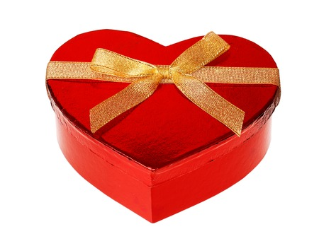 golde: One heart shaped unopend red glossy gift box with a golden ribbon, isolated on white background.