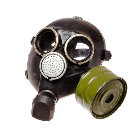 A vintage military gas mask with air filter isolated on white