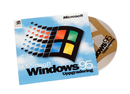 Stockholm, Sweden - December 15, 2014:  Microsoft Windows 95 operating system cover with CD for the Swedish version, isolated on white background. Editorial