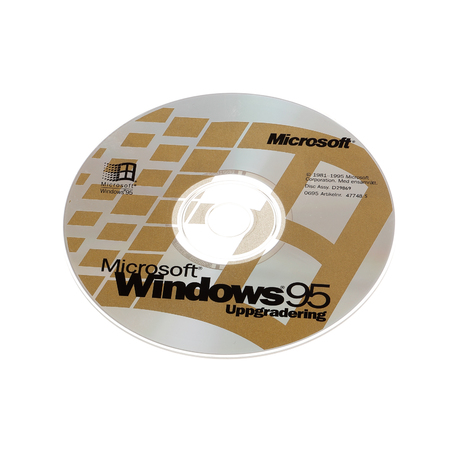 operating system: Stockholm, Sweden - December 15, 2014: One CD-ROM disk with the Swedish version of the operating system Microsoft Windows 95 upgrade, isolated on white background.