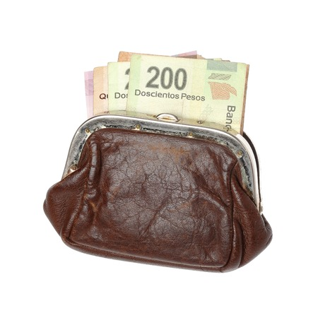 pesos: Brown purse with Mexican pesos isolated on white background.