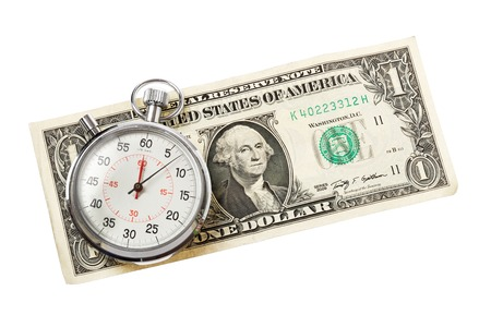 A ticking stopwatch on a US Dollar banknote isolated on white background. photo