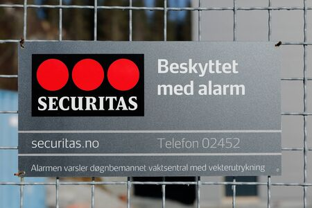 security company: Securitas is a security company that with this sign announces that they protect the area inside the fence. In this case, Norway. Editorial