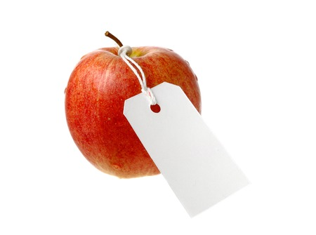Red apple with white not yet written attached label, isolated on white background.