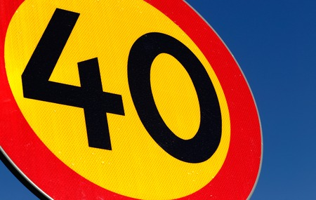 sky is the limit: Close-up of a Swedish speed limit 40 kmh road sign on blue sky.