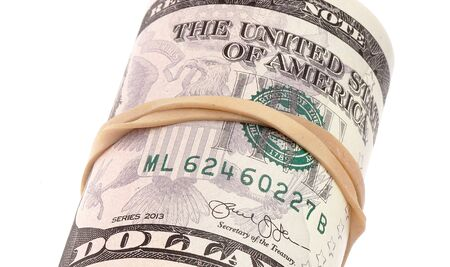 pf: Close up pf rubber band wrapped roll with five dollars banknotes on white background. Stock Photo