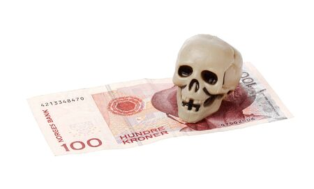 Norwegian 100 kroner bill with a small plastic scull isolated on white background.