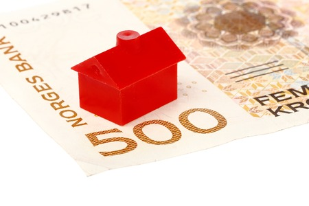 litle: One red litle building located on a Norwegian 500 kroner bill isolated on white background.