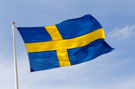 The flag of Sweden flying in the wind.