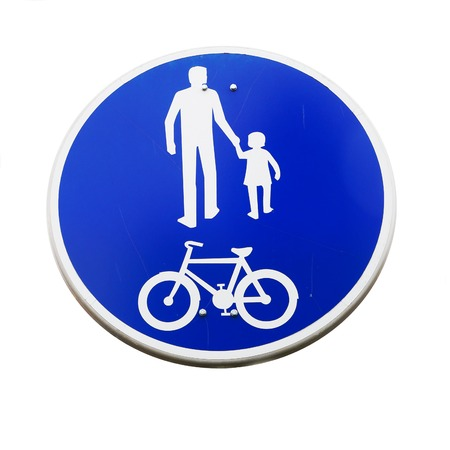 compulsory: Finnish road sign indicating a compulsory track for pedestrians and cyclists isolated on white.