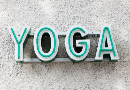 lifestile: Youga sign on building. Stock Photo
