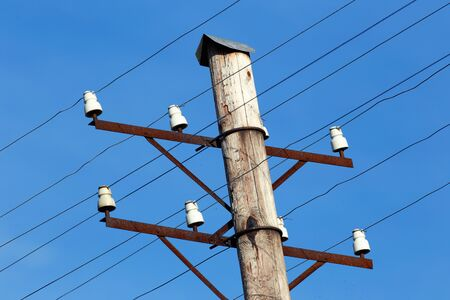 bare wire: Close-up of a telephone pole