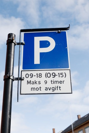fee: Norwegian parking sign with additional plate with parking rules. Parking fee 9-18 working days and 9-15 on Saturdays.