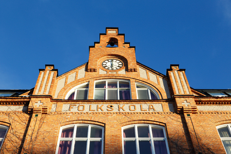 education in sweden: Detail of a school building of brick for the Swedish compulsory school in the previous school system was an elementary school folkskola.