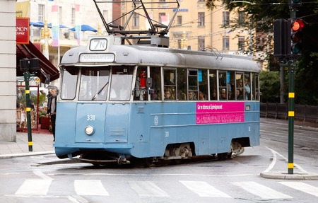 electric tram: Stockholm, Sweden - July 29, 2015:  Vintage tram  type A31 Mustang nr 331 in service for company AB Stockholms Sprvgar SS on Hamngatan turning to the stop at Normalmstorg. Editorial