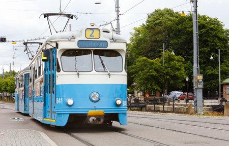 couplers: Gothenburg, Sweden - July 1, 2014: Tram Type M29 number 841 on line 2 with the destination Hgsbotorp on Stampgatan at the tram stop at Drottningtorget. Editorial