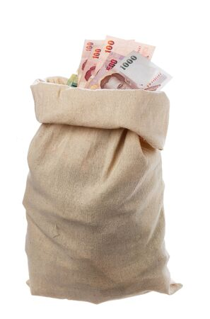 full filled: One sack filled with Thai money isolated on white.