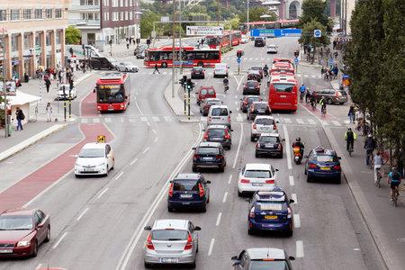 busses: Stockholm, Sweden - August 31, 2015: Traffic on the street Langholmsgatan at Hornstull. Editorial