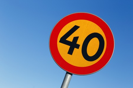 sky is the limit: Swedish speed limit 40 road sign on blue sky. Stock Photo