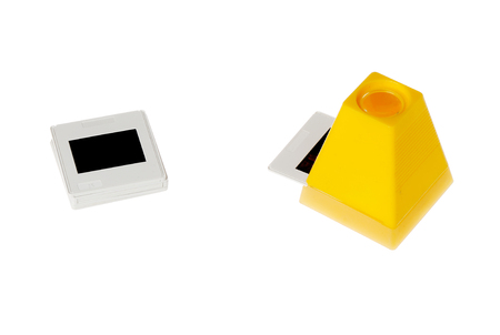 viewer: One yellow slide viewer with an inserted slide isolated on white. Stock Photo