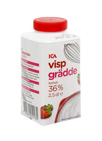 2 5: Stockholm, Sweden - Mars 20, 2016: A pack ICA brand whipping cream 36% 2,5 dl for the Swedish market, isolated on white background.