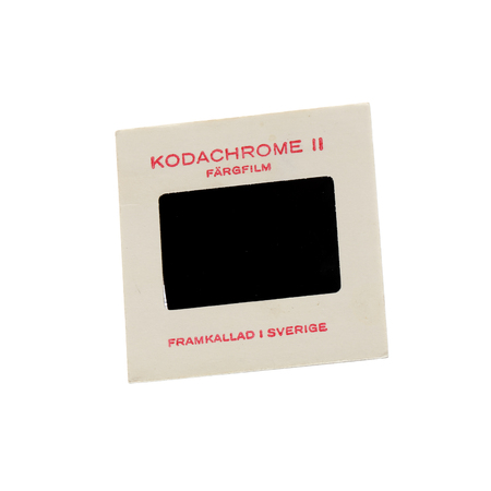 kodak: Stockholm, Sweden - March 20, 2016: A Kodak Kodachrome II slide in cardboard frame with color film developed in Sweden in the early 1960s isolated on white background.