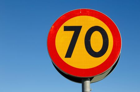 sky is the limit: Sweddish speed limit sign 70 on blue sky.