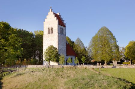 stepped: Exterior of Vasterhejde churchin Swedish province of Gotland, with stepped gables on church tower.