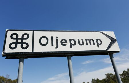oil well: The sign shows the way to the attraction, oil pump in disused oil well in the Swedish province of Gotland. Stock Photo