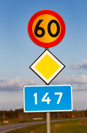 kmh: Signs for speed limit 60 kmh, primary road and road number 147 in the Swedish province of Gotland.