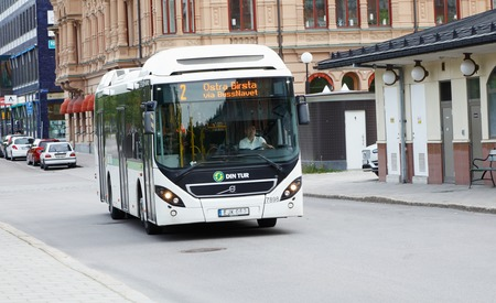 trafic: Sundsvall, Sweden - May 30, 2016: One white public transport city bus in downtown Sundsval in trafic on line number 2.l