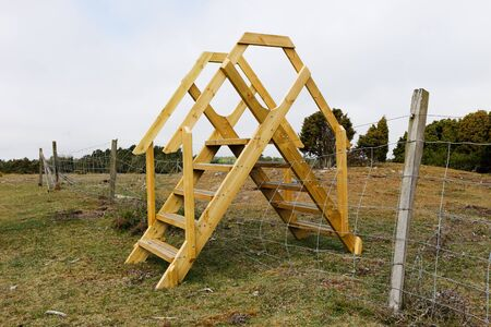 stile: A stile create a transition over the fence.