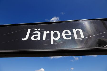 A sign at the railroad station in the small Swedish town Jarpen. Stock Photo
