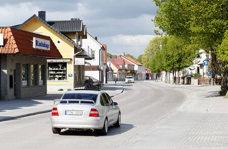 trafic: Hemse, Sweden - May 14, 2016: A car heading north thrue on the main street Storgatan the small town Hemse in the Swedish province of Gotland.
