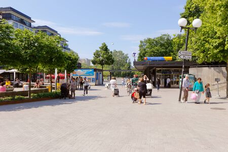 solna: Solna, Sweden - June 3, 2016: People at the square at Solna centrum near the underground station Solna Centrum. Editorial