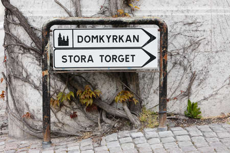 Signpost with direction to the cathedral and main square in Visby Sweden. Stock Photo
