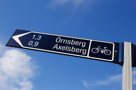 Signposts for cyclists with a distance of neighborhoods Ornsberg and Axesberg in Stockholm.