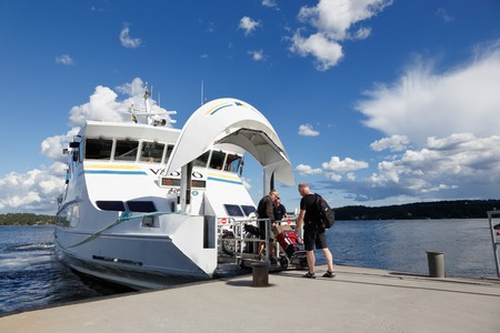 passenger ship: Lidingo, Sweden - July 4, 2016: The passenger ship in ms Vaddo make a stop at Gashaga pier for passenger exchange. The ship servce public transport operated by Waxholmsbolagets archipelago traffic in Stockholm county. Editorial