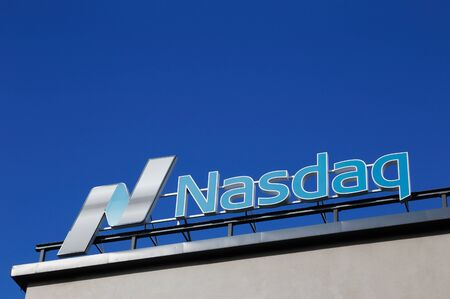 nasdaq: Stockholm, Sweden - July 4, 2016: Close up of the Nasdaq roof sign at the office in Stockholm at the Tullvaktsvagen street against the blue sky.