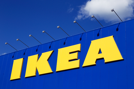 furniture store: Uppsala, Sweden - July 6, 2016: Close-up of the sign at the Ikea furniture store building in Uppsala.