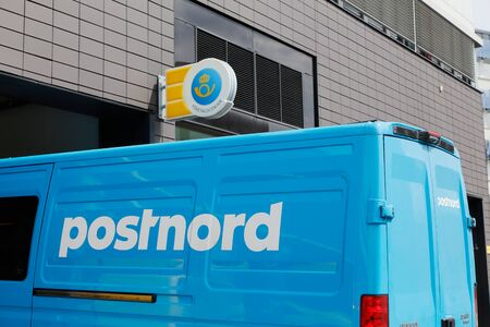 solna: Solna, Sweden - June 15, 2016: A blue van marked with Postnord the Swedish postal service parket outside the office at the street  Englundavagen in  Solna Buissness park.. Editorial