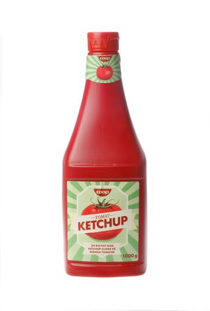Stockholm, Sweden - April 30, 2016: A red plastic bottle with 1000 grams Coop tomato ketchup for the Swedish market isolated on white background.