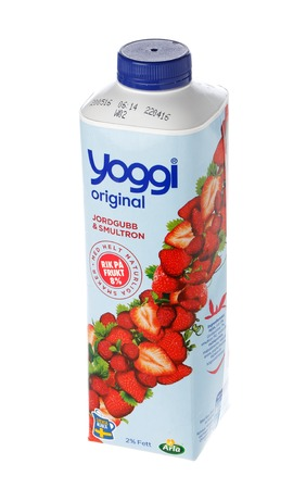 Stockholm, Sweden - May 5, 2016: A container with a screw cap containing 1000 grams Yoggi original yogurt with strawberry and strawberry produced by Arla for the Swedish market isolated on white background. Editorial