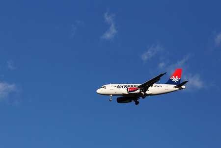 Marsta, Sweden - July 6, 2016: An Airbus A319-132 (YU-APB) in service with Air Serbia on approach to Stockholm Arlanda Airport with deployed landing gear. Editorial