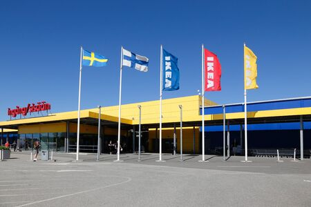 Haparanda, Sweden - July 20, 2016: Exterior of the Ikea furniture store near the border with Finland, with bilingual entrance sign above the entrance. Editorial